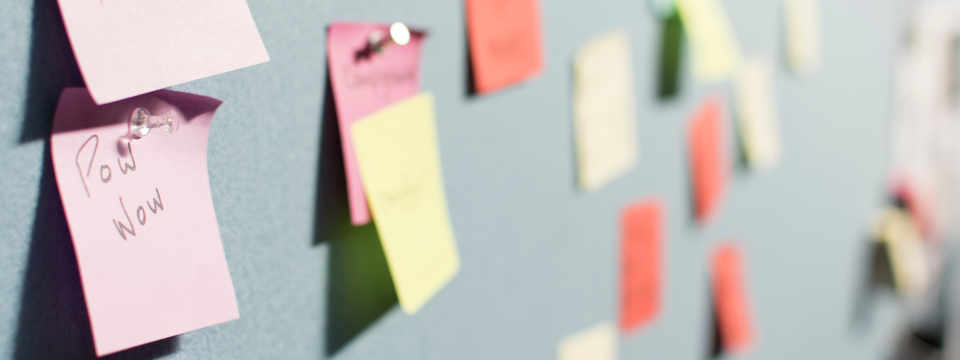 Post it notes on a wall, remember to claim your work expenses!